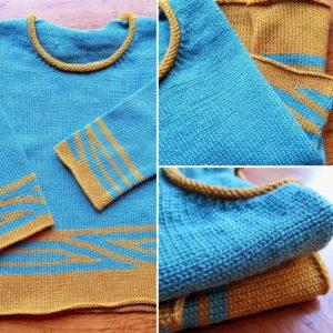 Pull tricoté en jersey bi-couleur avec un petit bord rond.
