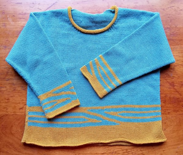 Pull enfant mixte, graphisme couleur, manches longues, col rond tricoté en jersey.